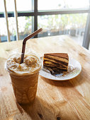 Coffee caramel frappe with whipped cream and Tiramisu cake in
