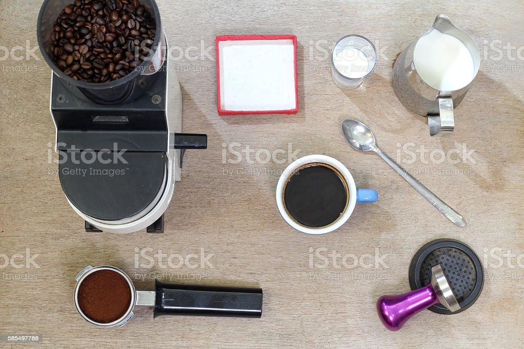 Coffee, coffee bean, coffee and wood on the floor. stock photo