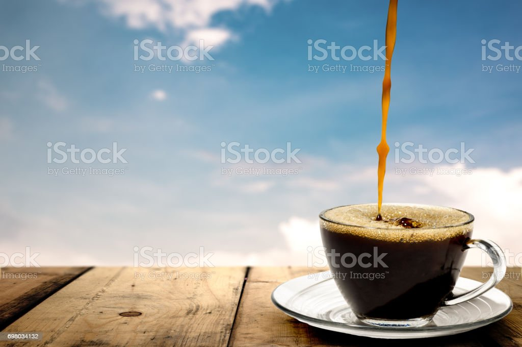 Coffee. Coffee Espresso. Cup Of Coffee and view of sky and cloud. stock photo