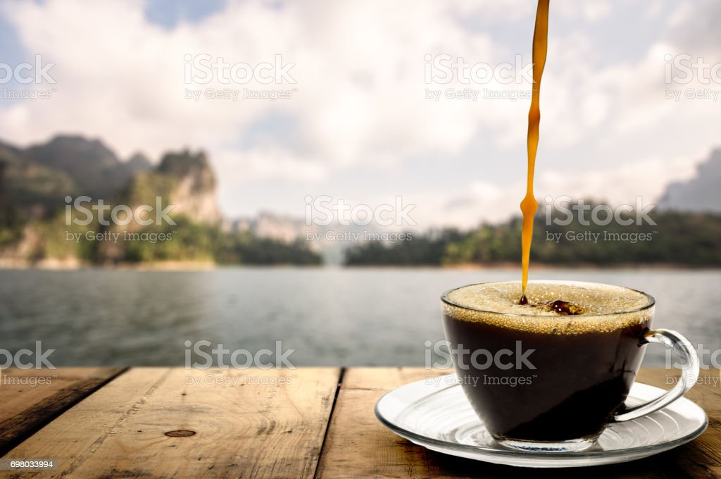 Coffee. Coffee Espresso. Cup Of Coffee view of lake and mountain. stock photo