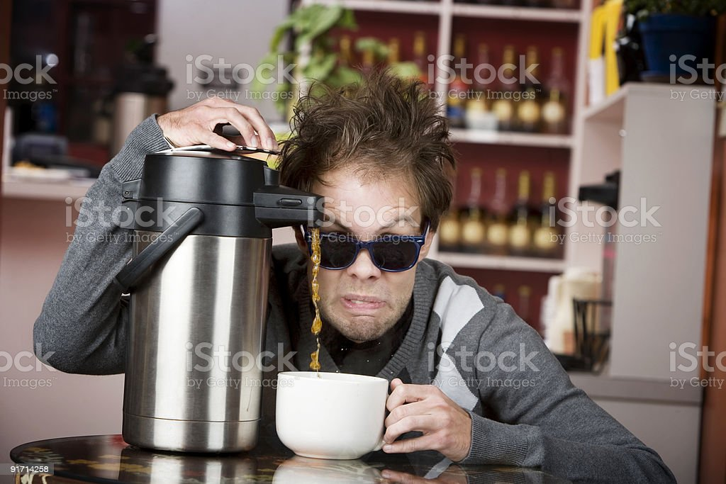 Coffee Crazed Young Man royalty-free stock photo