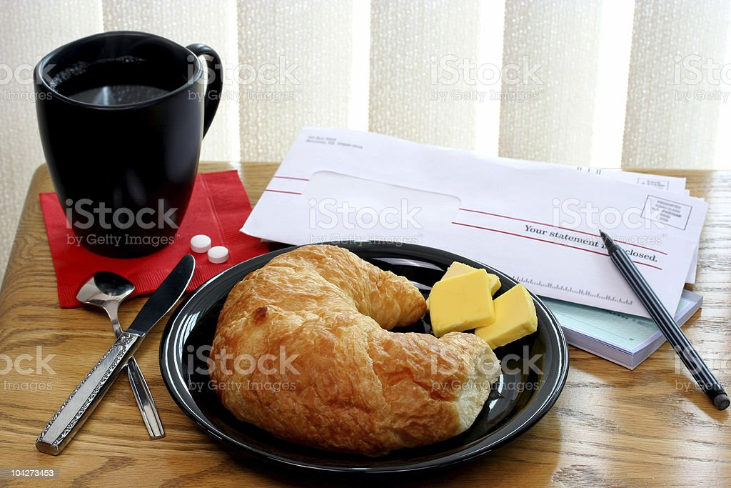 Coffee, Croissant and Bills royalty-free stock photo