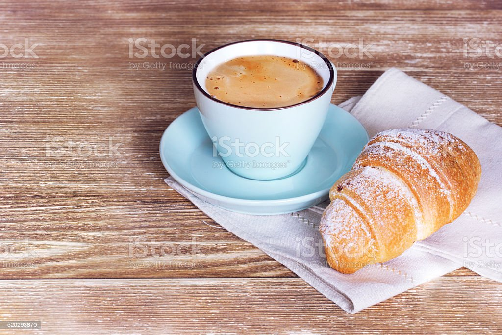 Coffee croissant on wooden background empty copy space. stock photo