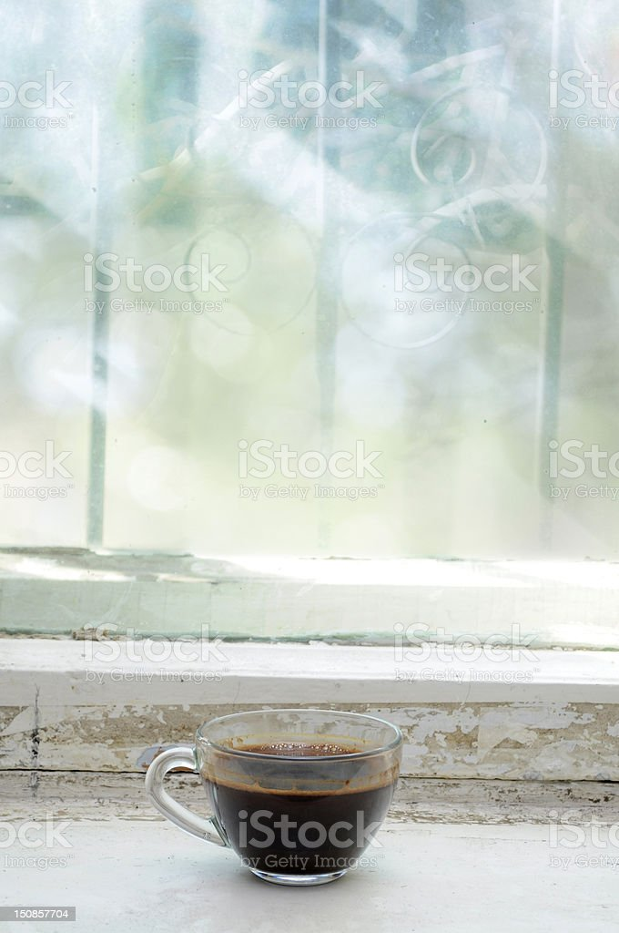 Coffee cup against the window royalty-free stock photo