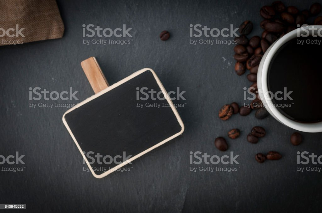Coffee cup and a slate stock photo