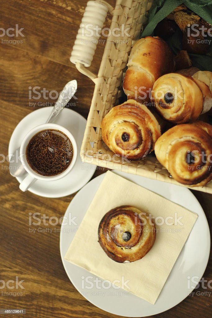 Coffee Cup and Bread Roll. Continental Breakfast. stock photo