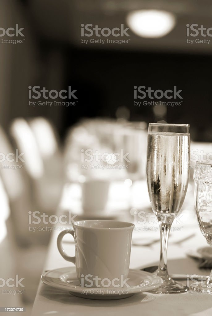 Coffee cup and champagne glass on set table royalty-free stock photo