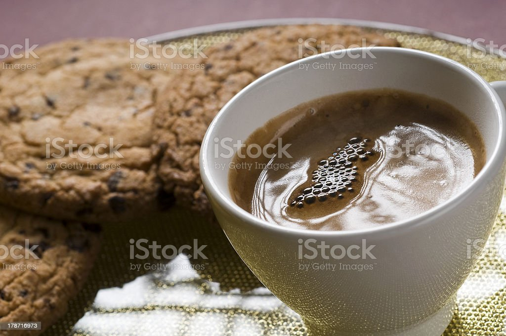 Coffee cup and chocolate cookies royalty-free stock photo