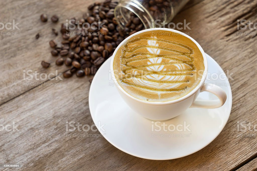 coffee cup and coffee bean stock photo