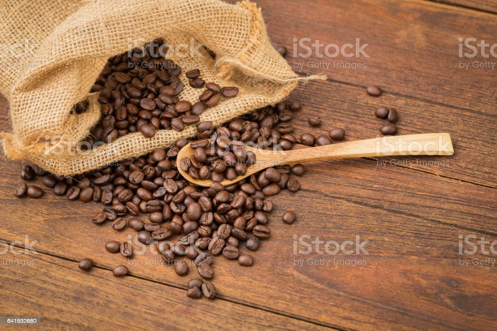 Coffee cup and coffee beans on wooden background. stock photo