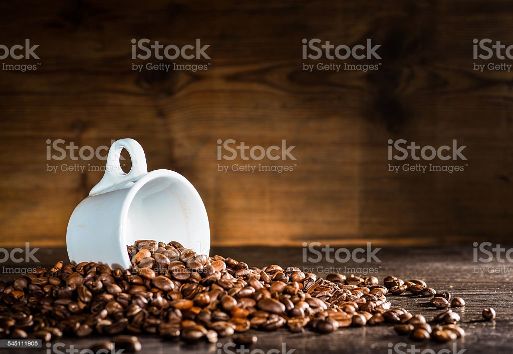 coffee cup and coffee beans stock photo