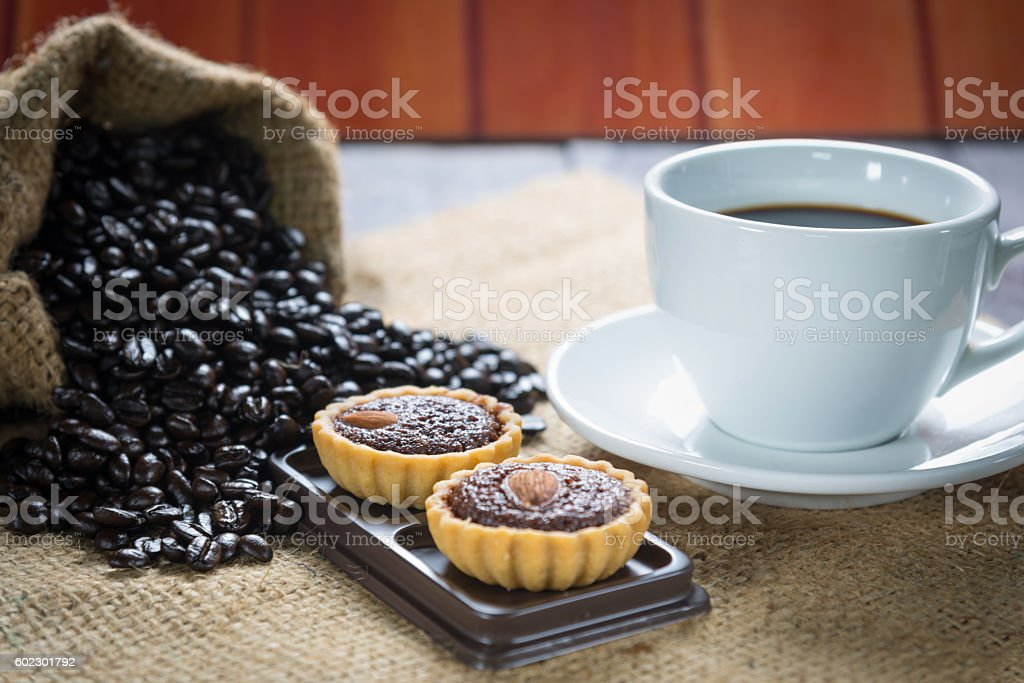 Coffee cup and coffee beans with brownie tarts stock photo