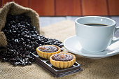 Coffee cup and coffee beans with brownie tarts