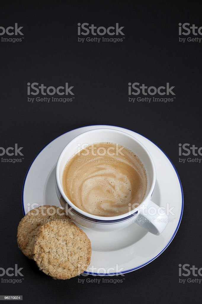 Coffee cup and cookies on black background stock photo