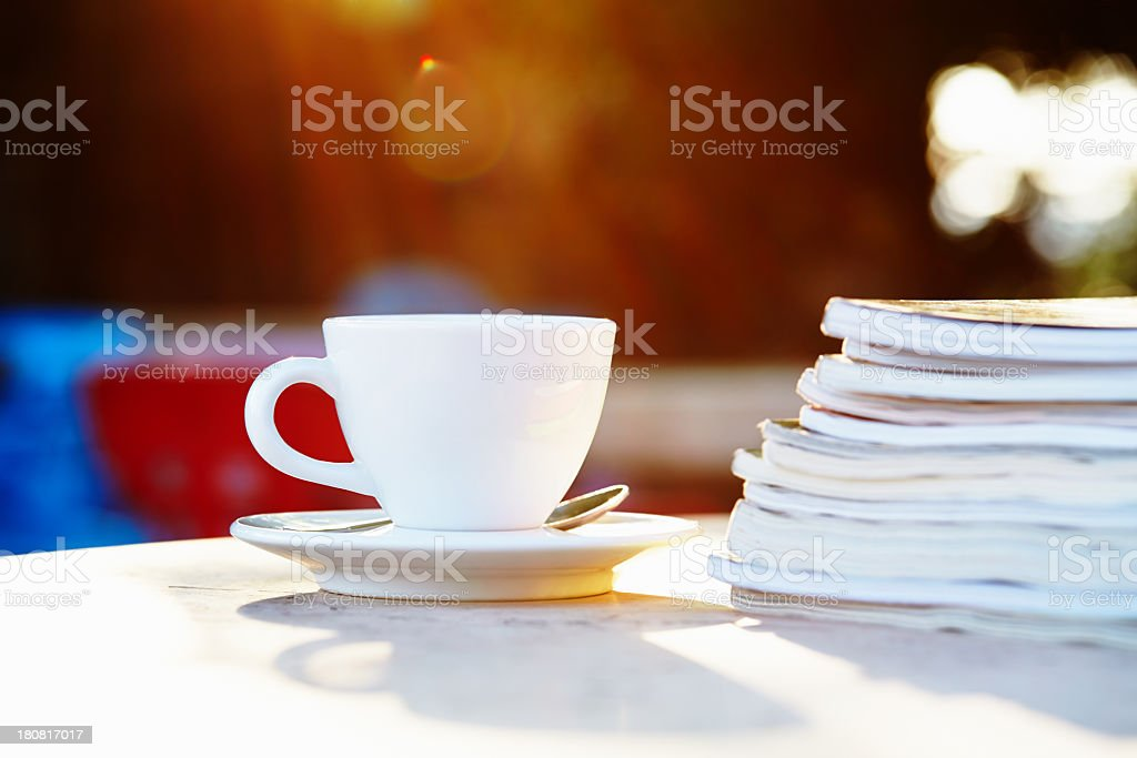 Coffee cup and magazines royalty-free stock photo