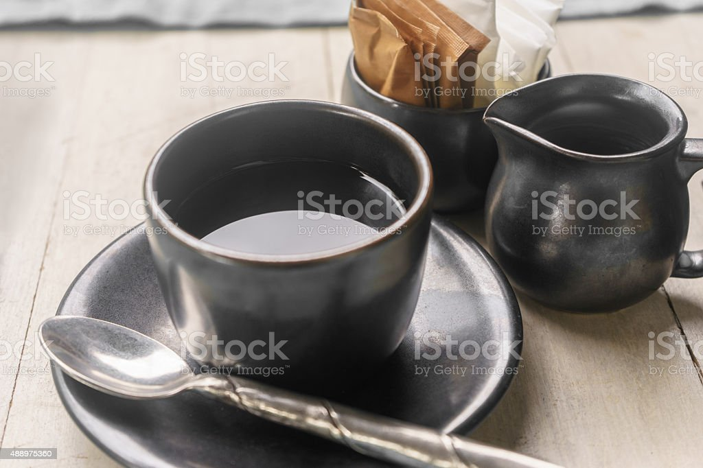 Coffee cup and milk cup with sugar and cream pack stock photo