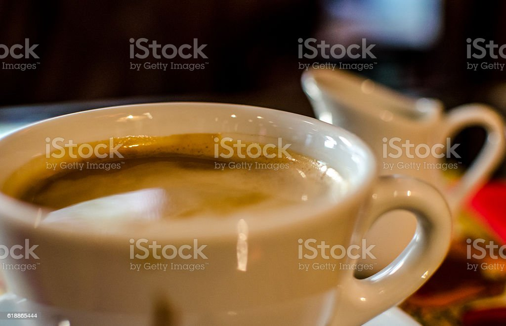 Coffee cup and milker stock photo
