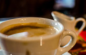 Coffee cup and milker
