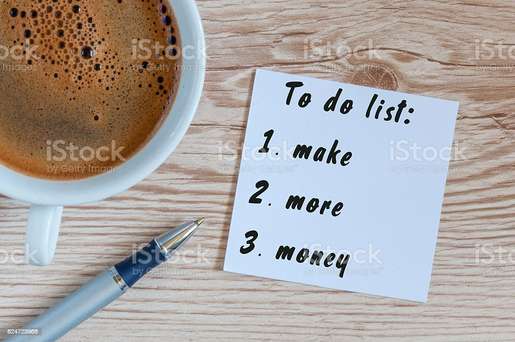 Coffee cup and notebook with To do list Make More stock photo