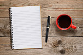 Coffee cup and notepad with pen