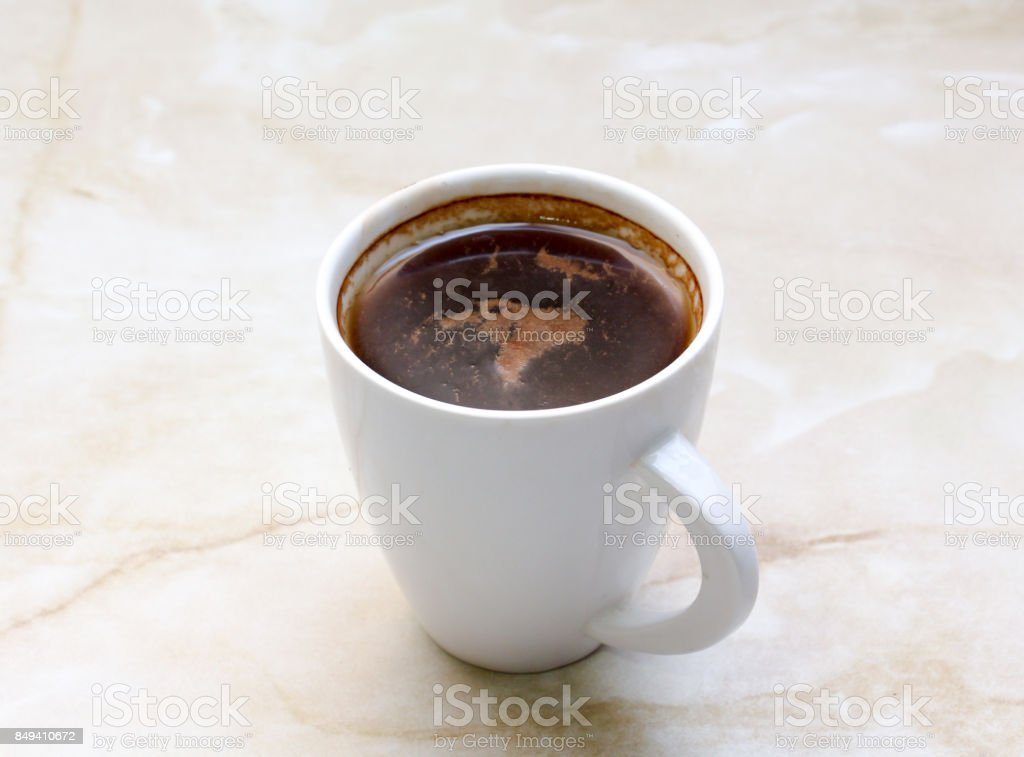Coffee cup and on a table. light background. stock photo