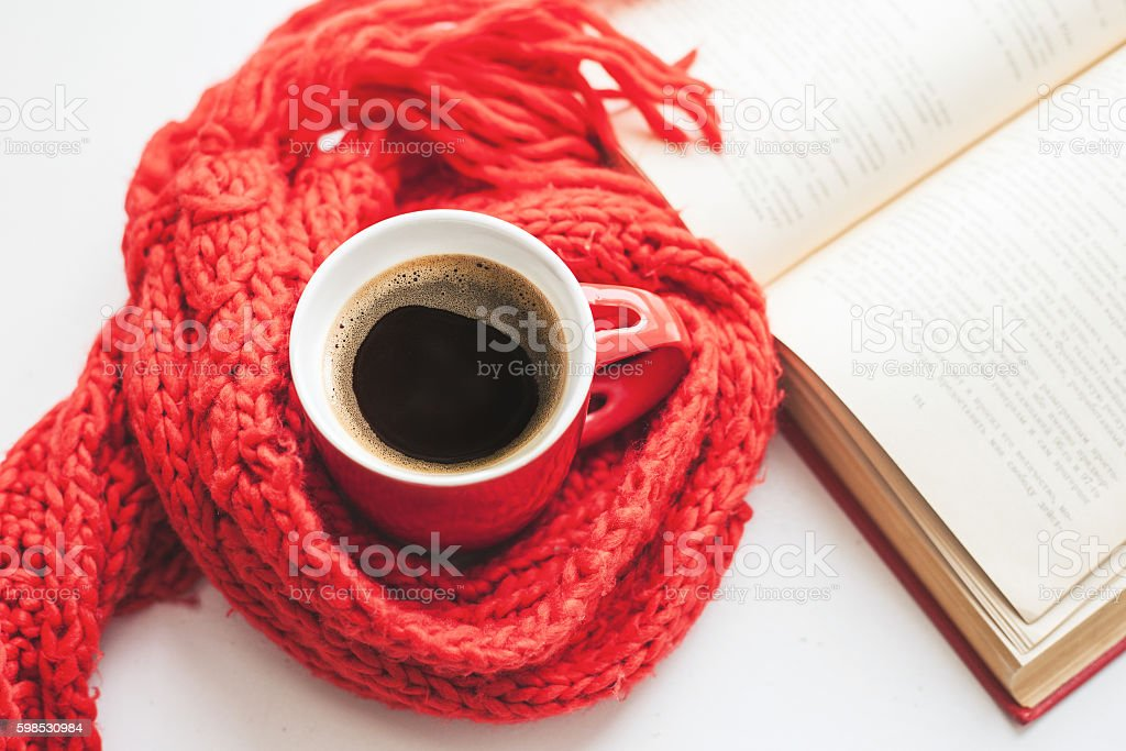 Coffee cup and open book stock photo