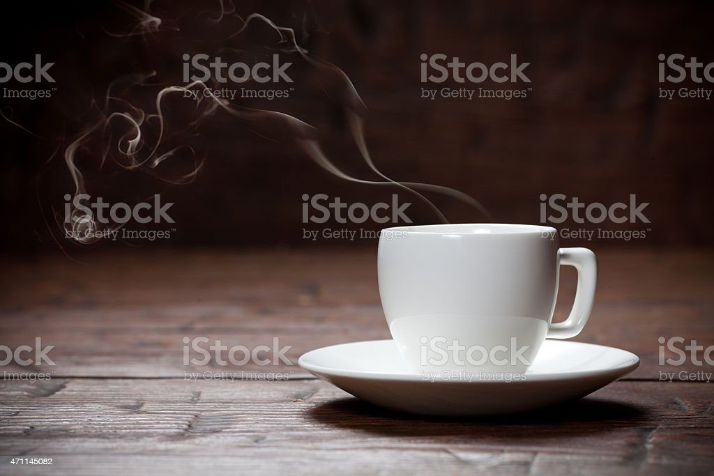 Coffee cup and saucer on old wooden table. stock photo