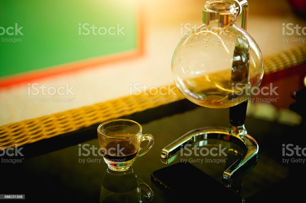 coffee cup and siphon vacuum maker stock photo