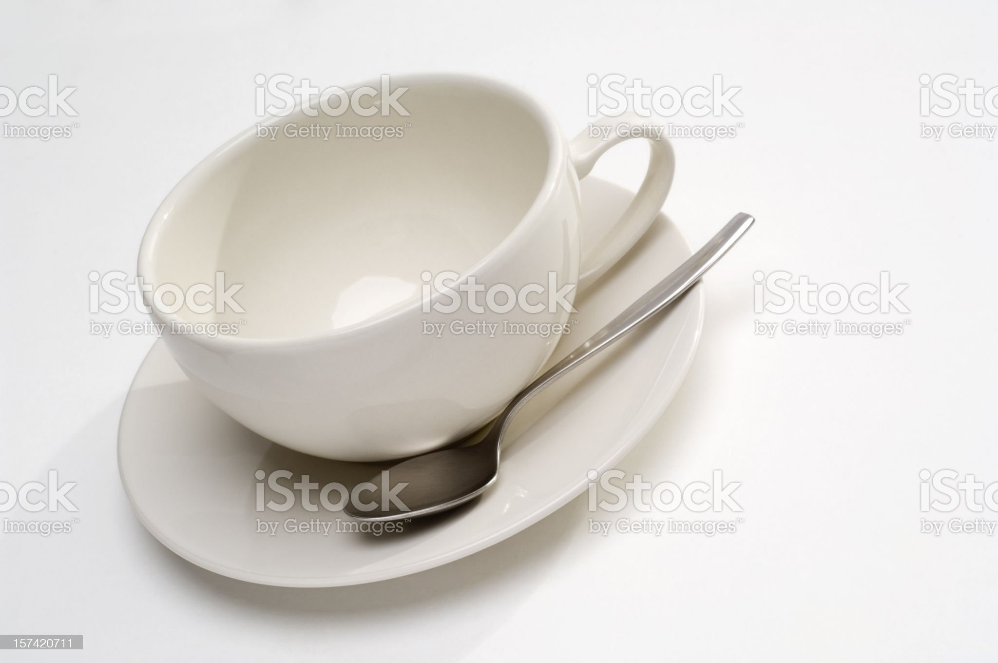 Coffee cup and spoon on white royalty-free stock photo