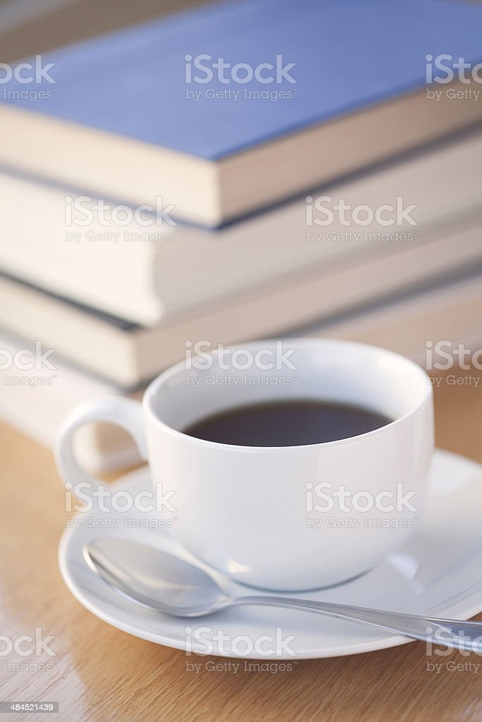 Coffee Cup and Spoon with Books royalty-free stock photo