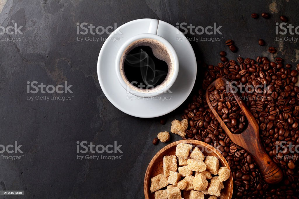 Coffee cup, beans and brown sugar stock photo