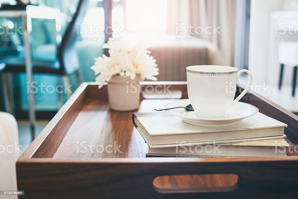 Coffee cup Book white flower on wooden tray Interior decoration stock photo