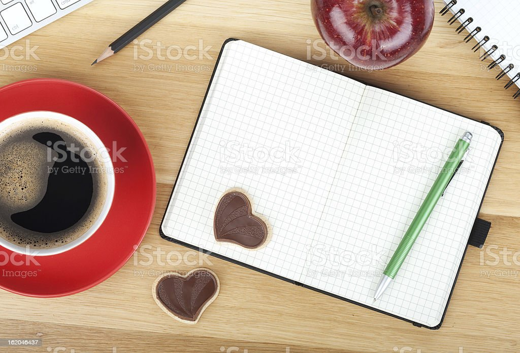 Coffee cup, cookies, red apple and office supplies royalty-free stock photo