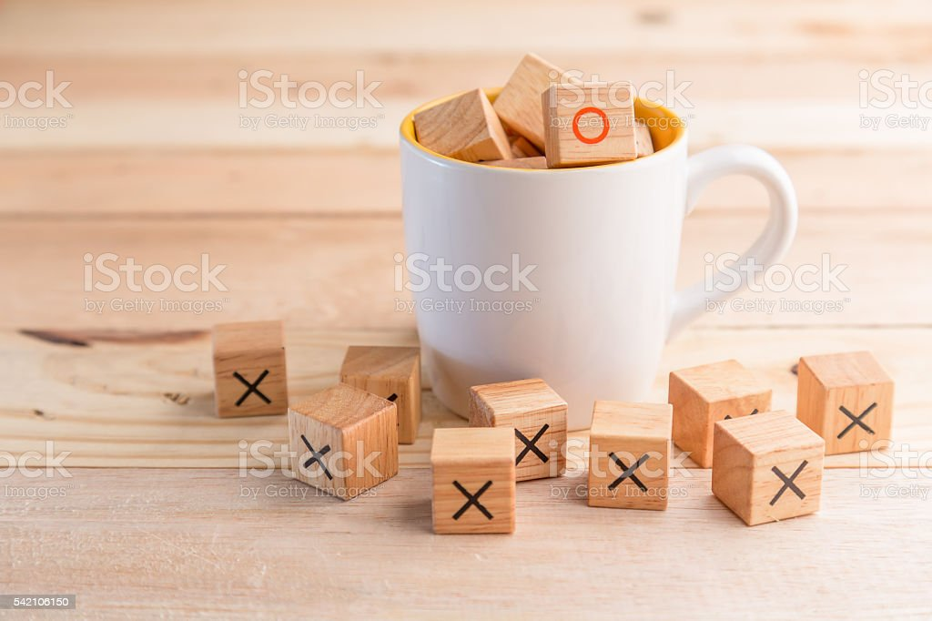 coffee cup fill with wood block business ideas concept stock photo