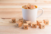 coffee cup fill with wood block business ideas concept