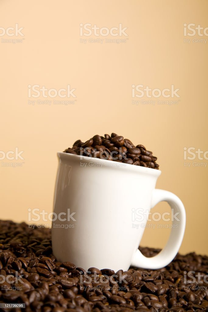 Coffee Cup Full of Beans royalty-free stock photo