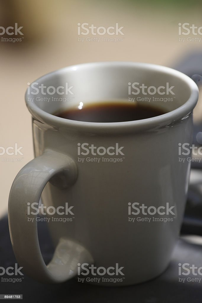 Coffee Cup in shade stock photo