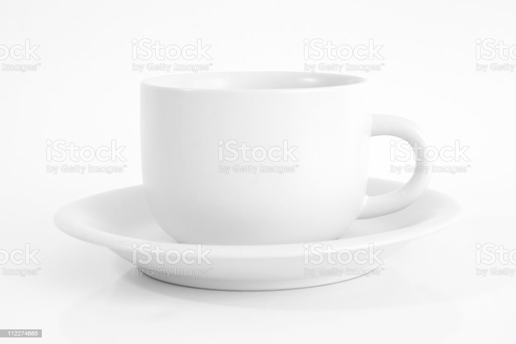 Coffee cup in white on white plate royalty-free stock photo