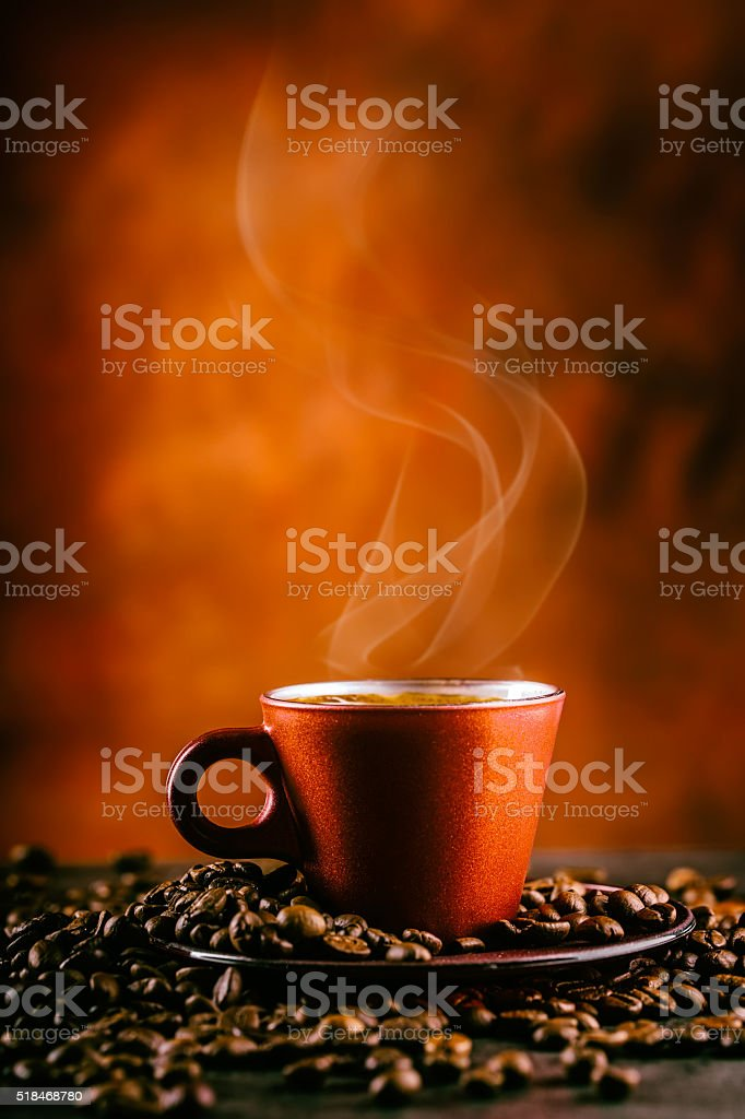 Coffee. Cup of black coffee and spilled coffee beans. stock photo