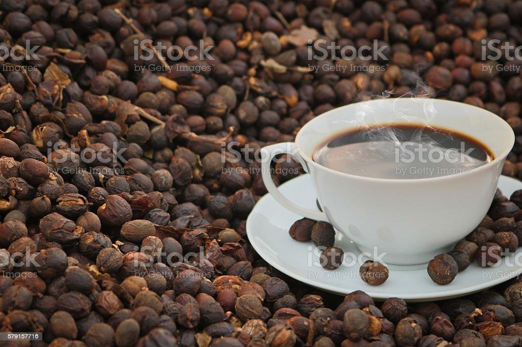 Coffee - Cup of coffee on dried coffee bean stock photo