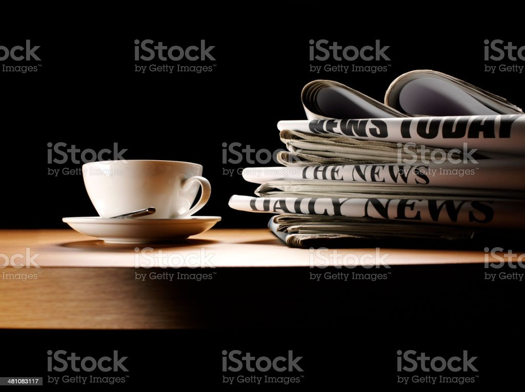 Coffee Cup on a table with Newspapers stock photo
