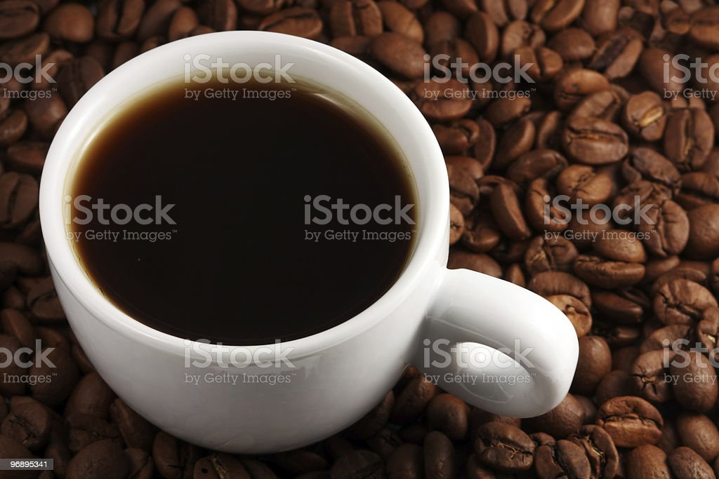 Coffee cup on beans royalty-free stock photo