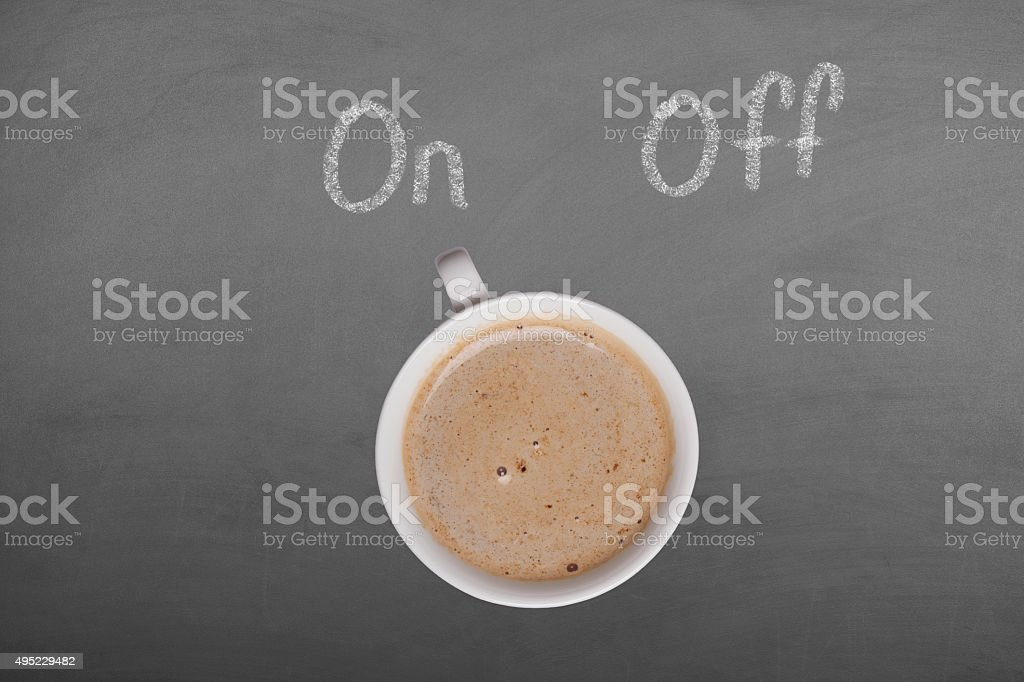Coffee cup on blackboard with on off stock photo
