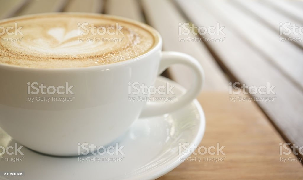 coffee cup on bokeh background in color style stock photo