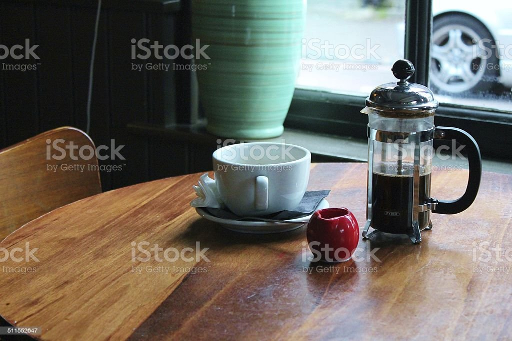 Coffee cup on cafe table cafetiere stock photo