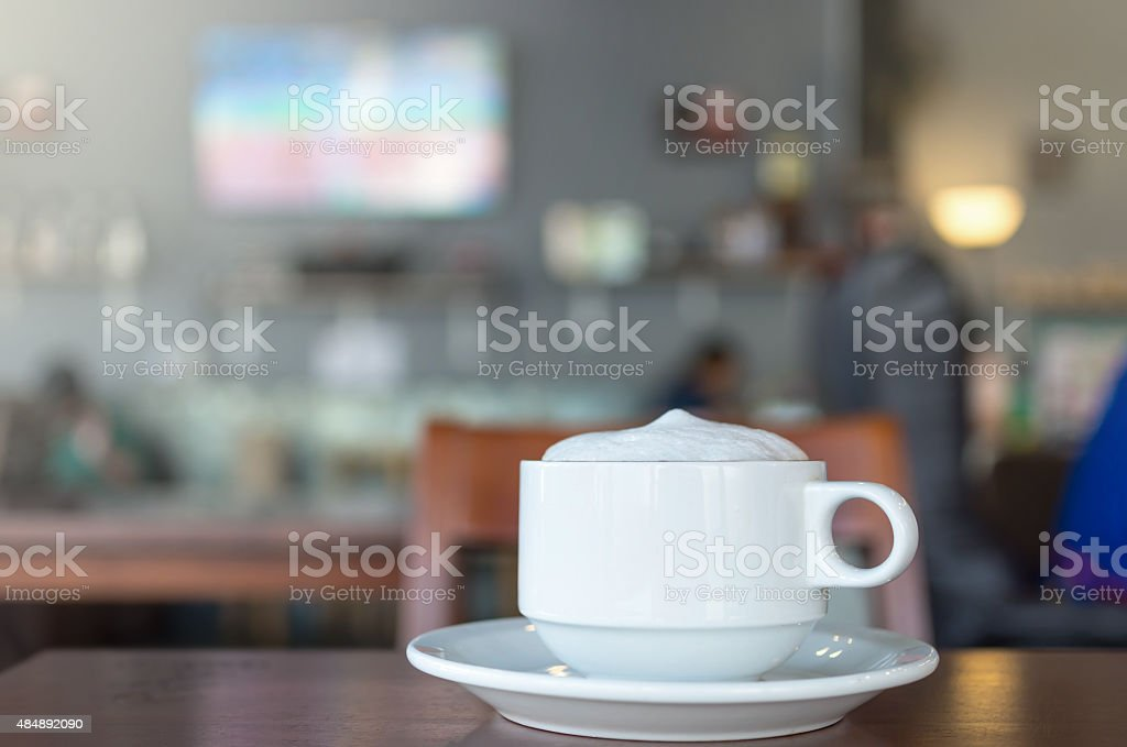 Coffee cup on coffee shop blur background stock photo