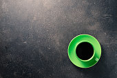 Coffee cup on dark table
