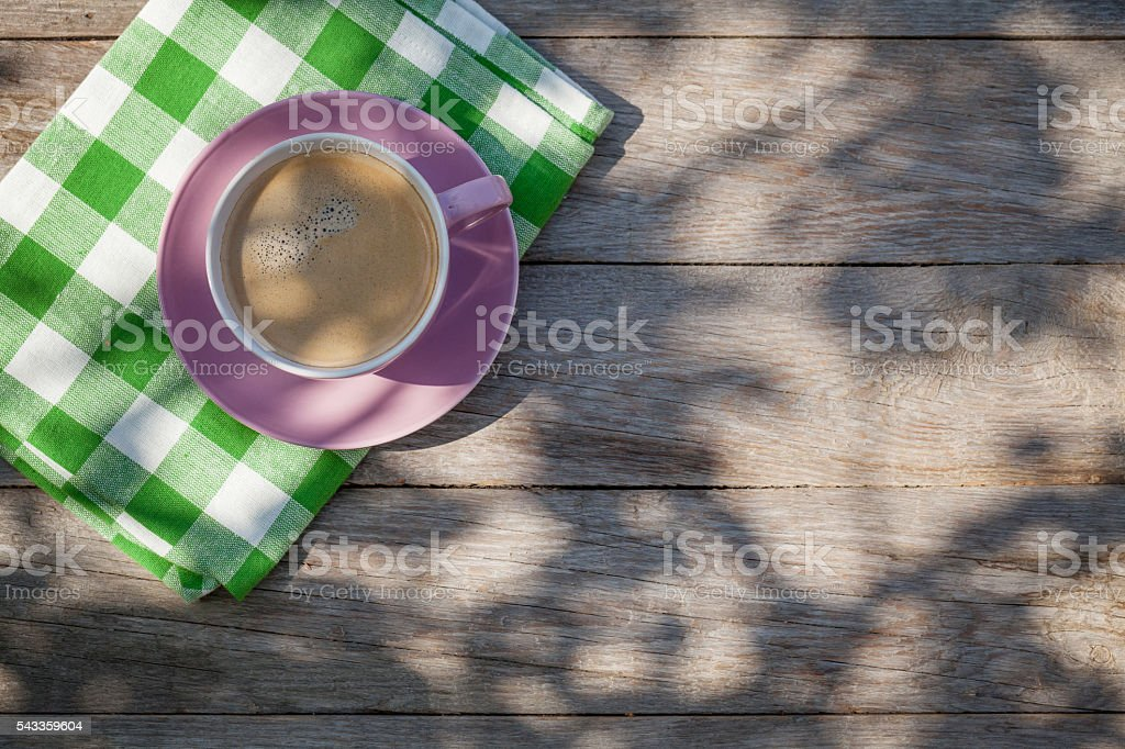 Coffee cup on garden table stock photo