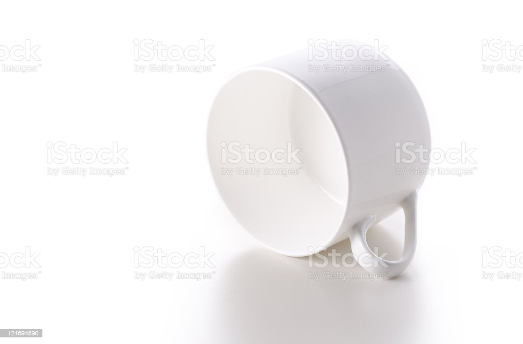 Coffee cup on its side royalty-free stock photo