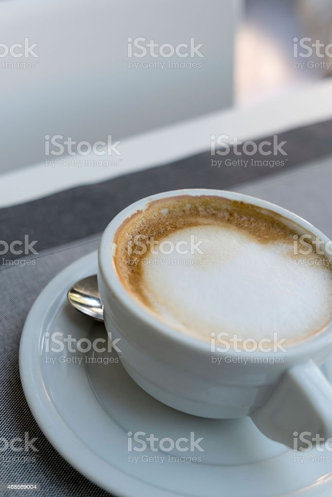 Coffee cup on restaurant table royalty-free stock photo